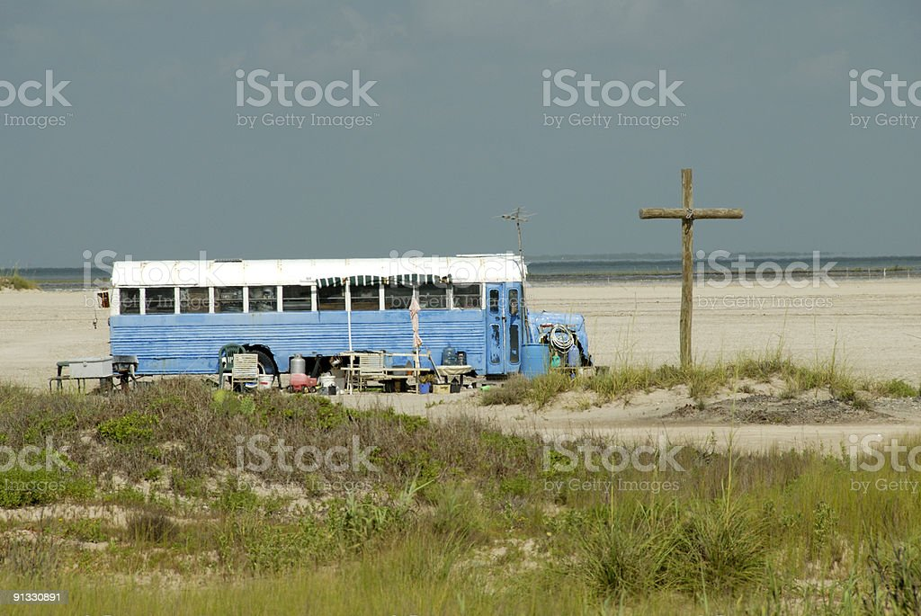 Old Blue Bus And Large Wood Cross On Beach royalty-free stock photo