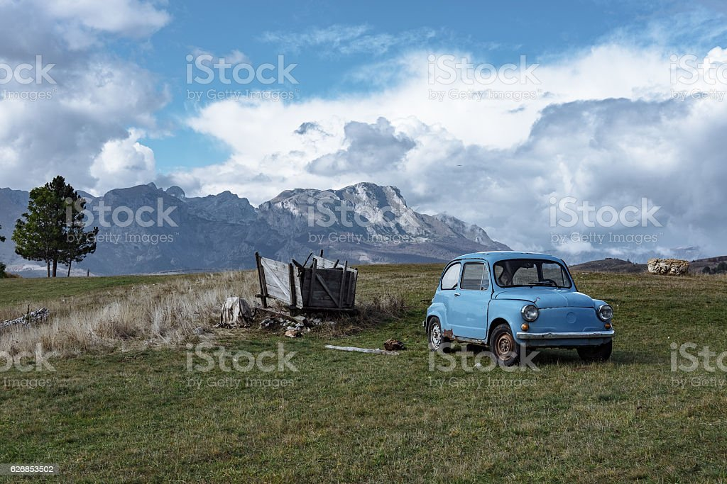 Old blue car on a background of beautiful mountains, Montenegro stock photo