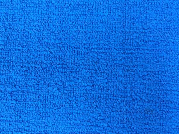old blue carpet - teppich hellblau stock-fotos und bilder