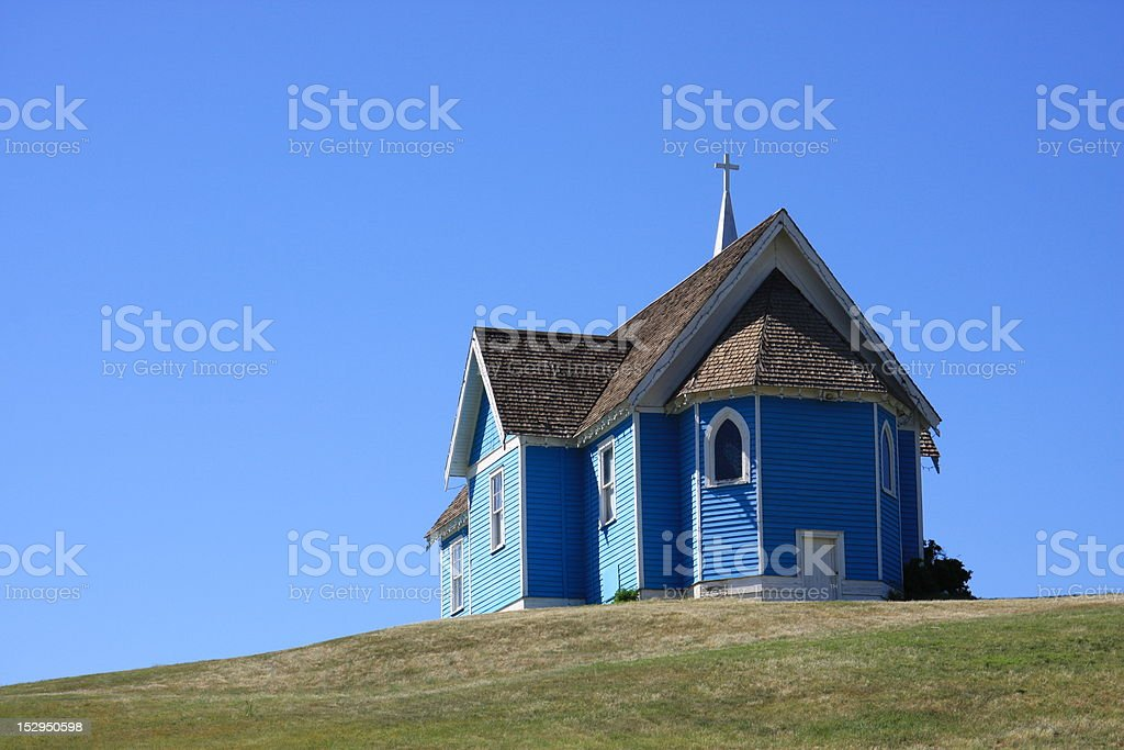 Old Blue Church on Top of a Hill royalty-free stock photo