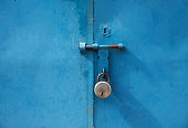 Old Blue Closed Door With Padlock