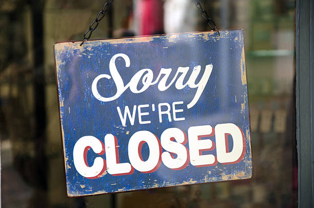 old blue closed sign hanging in a shop window - closed stock photos and pictures