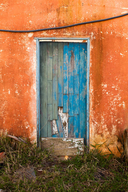 Old blue colored door in abandoned house in countryside stock photo