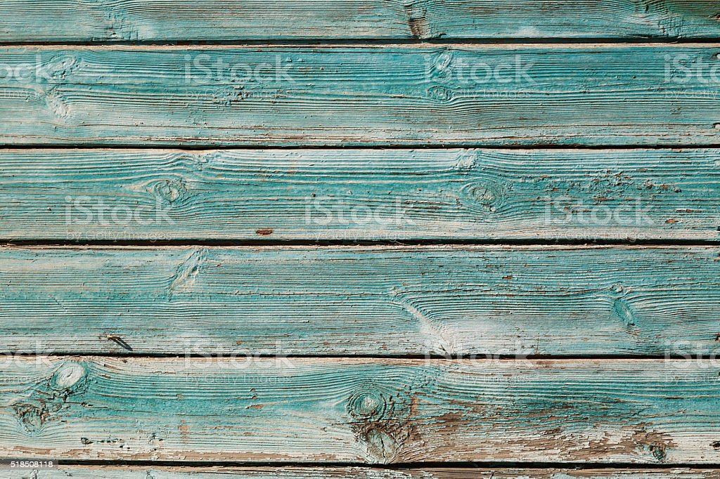 Old blue cracked paint on wooden background stock photo