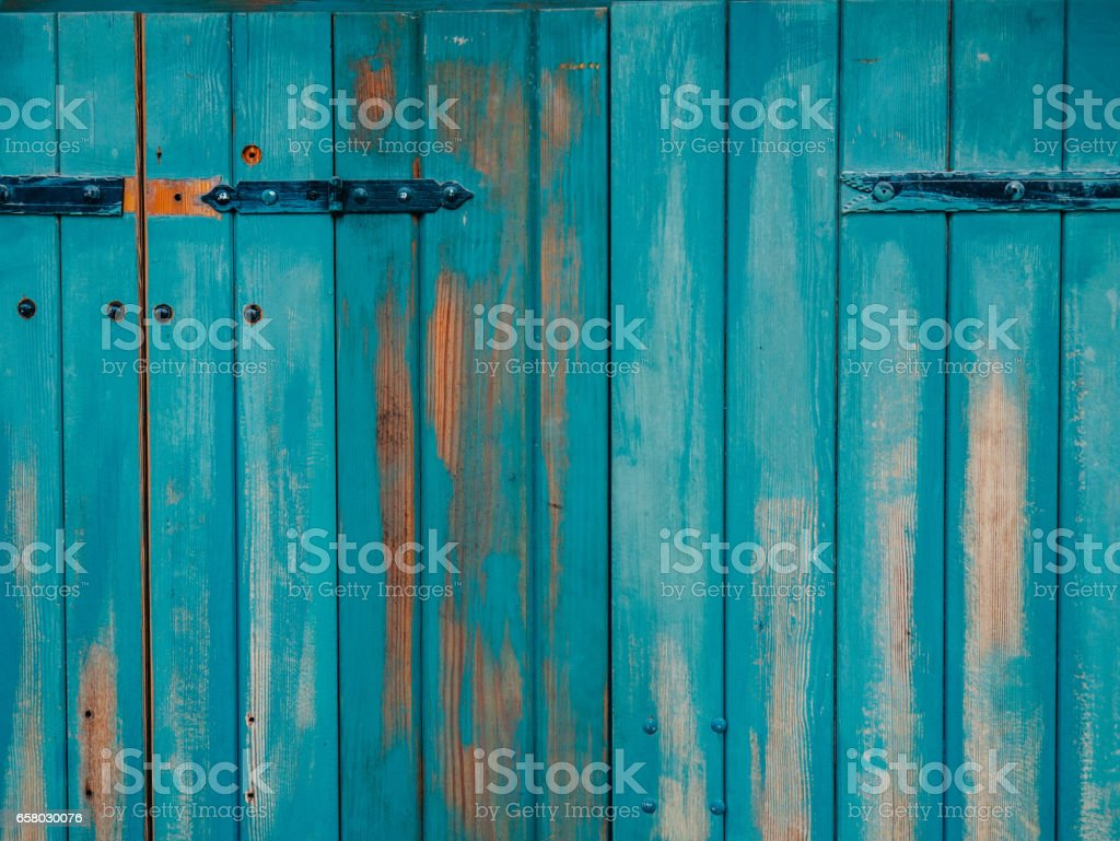 Old blue doors. Wood texture. Texture of metal stock photo