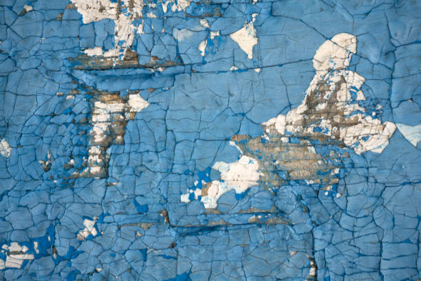 Old, blue, exfoliated, peeling paint on the concrete wall. The background. Texture. Old, blue, exfoliated, peeling paint on the concrete wall. The background Texture dilapidate stock pictures, royalty-free photos & images