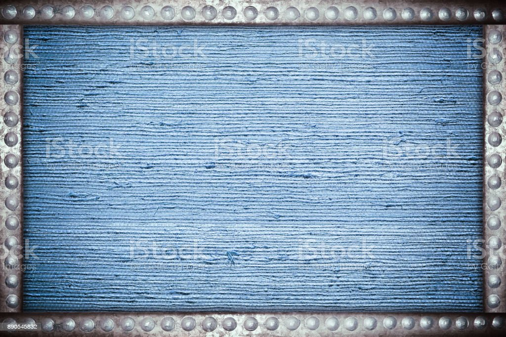 Old blue fabric background with metal rivets frame stock photo
