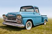 A Classic American Pickup Truck Sitting in a Field.