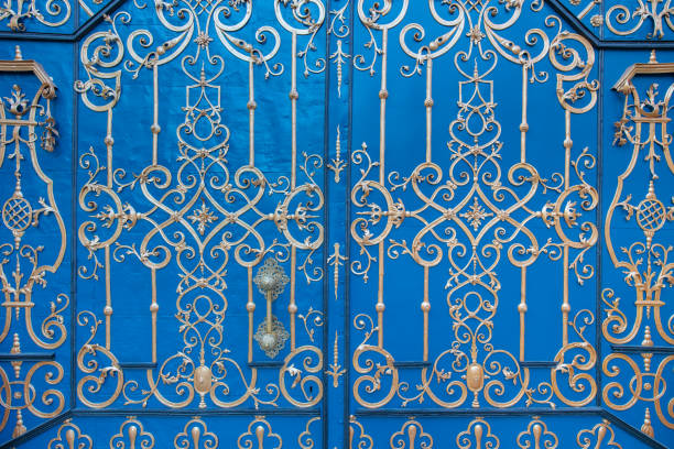 old blue gate with gold ornaments stock photo