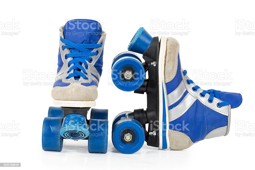 Old blue rollerblades stock photo