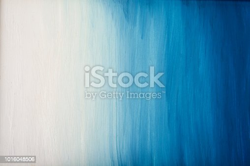istock Old  blue sky art cracked painting background 1016048506