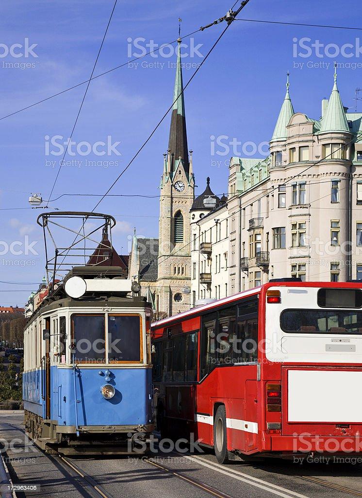 Old blue tram meets red bus along Strandvägen, Stockholm royalty-free stock photo
