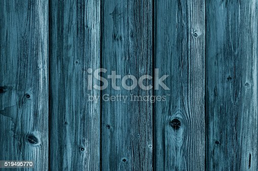 470521655istockphoto Old blue weathered wooden board 519495770