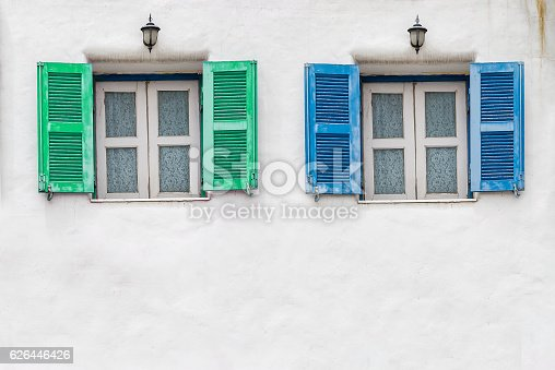 istock Old blue window and Old green window with white wall 626446426