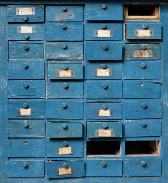 Old blue wooden cabinet with drawers stock photo