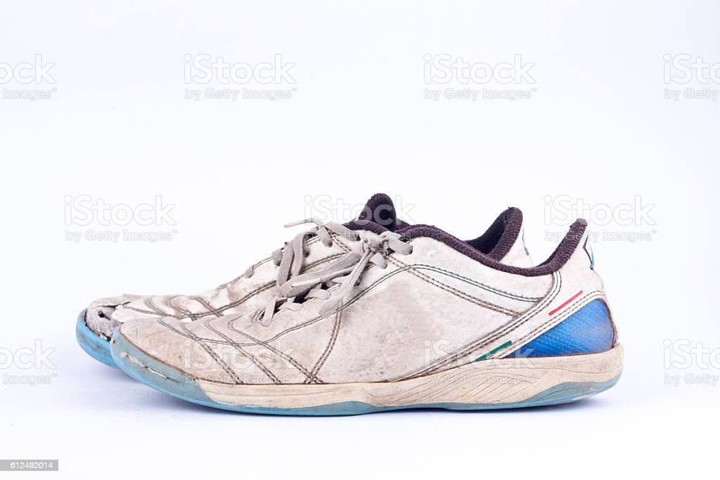 Old blue worn out futsal sports shoes stock photo