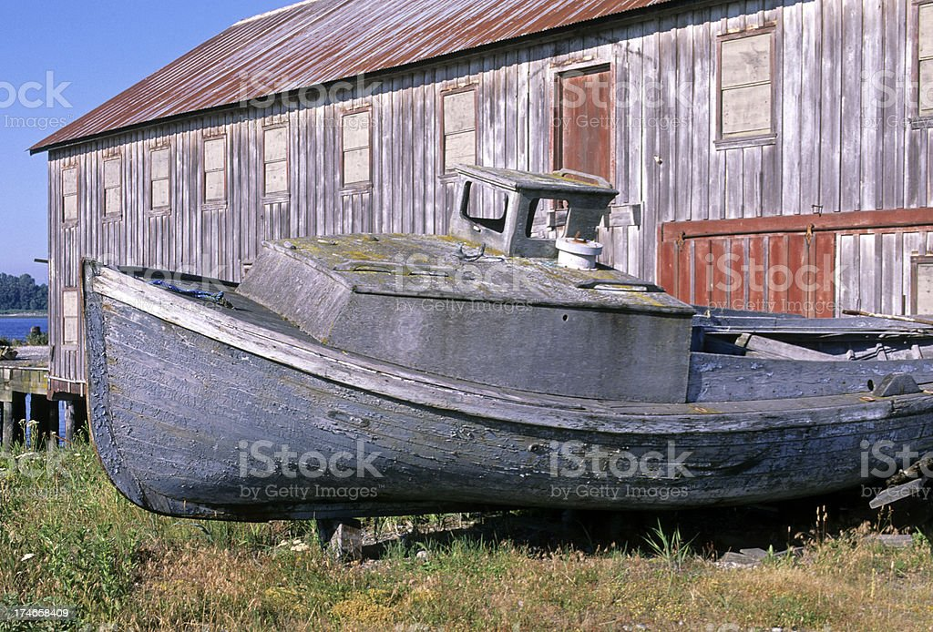 Old boat and disused oyster factory royalty-free stock photo