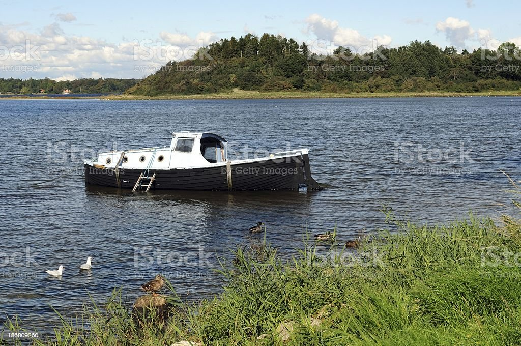 Old boat at the seaside royalty-free stock photo