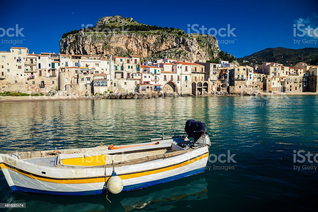 old boat drifting in a Cefalu harbor stock photo