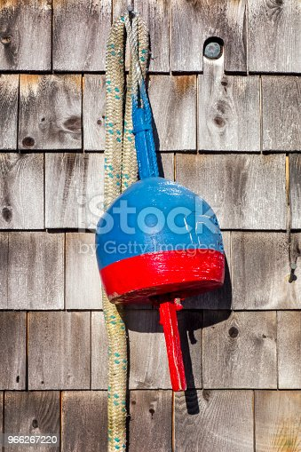 Fender on wooden cottage