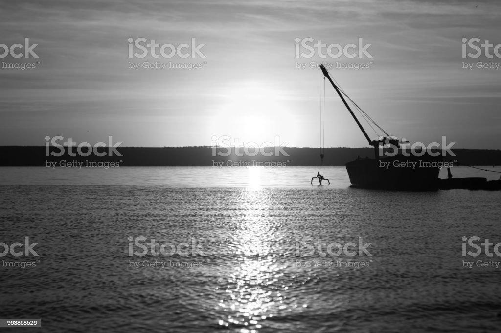 Old boat on a lake sunset. Kuyalnik estuary, Odessa, Ukraine - Royalty-free Abandoned Stock Photo