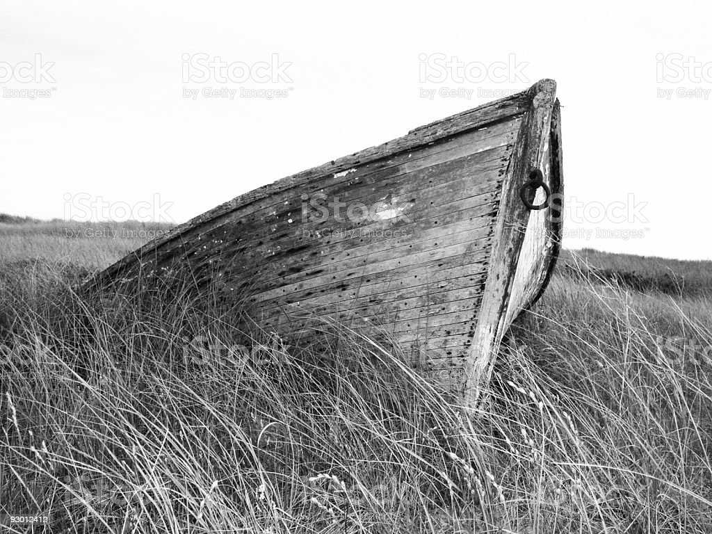 Old Boat on Grassy Beach royalty-free stock photo