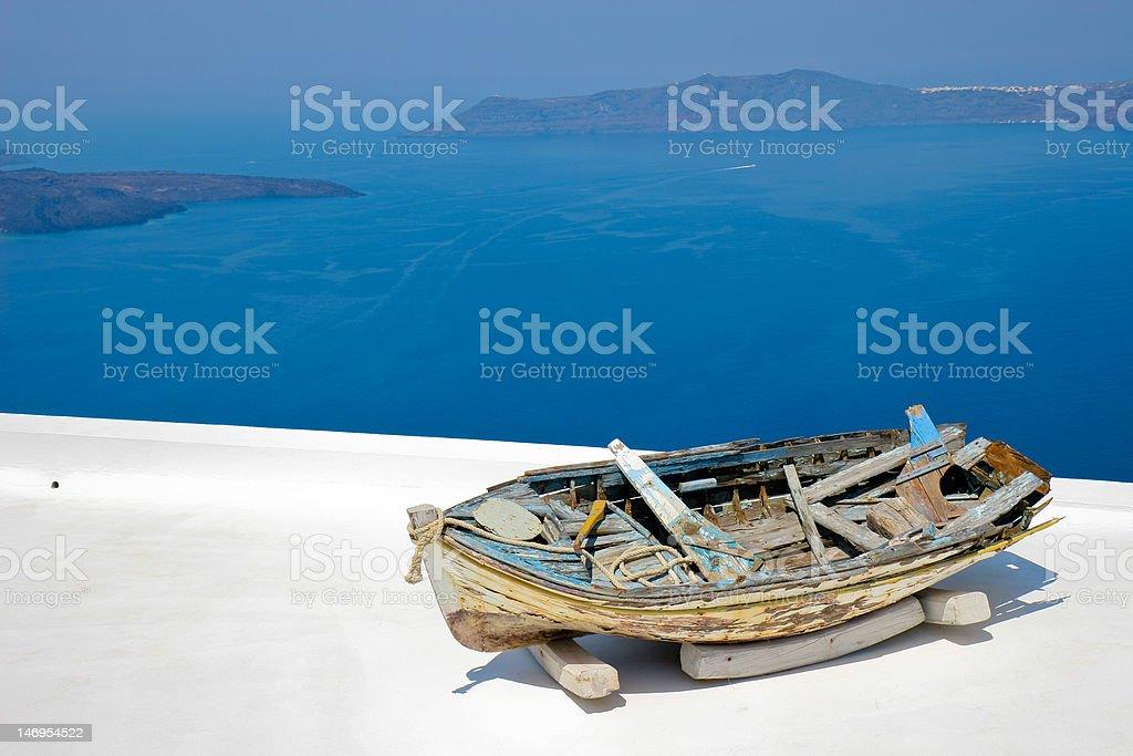Old boat on terrace overlooking the Mediterranean Sea stock photo