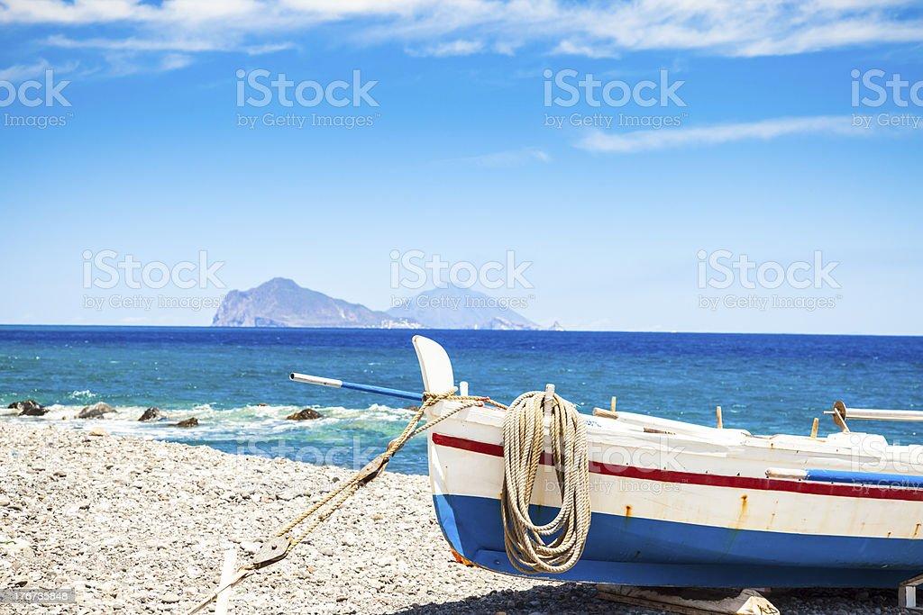 Old boat on the beach (Sicily, Italy) stock photo