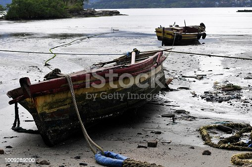 Abandoned old boat on the beach of Ilhabela, Sao Paulo, Brazil