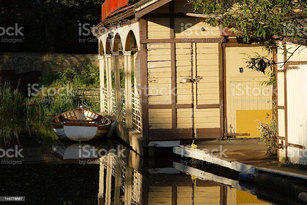 Old boathouse at sunset stock photo