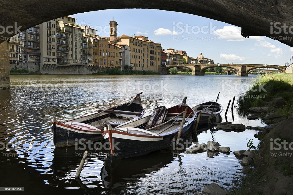 Old Boats Moored On The Arno River.Color Image stock photo