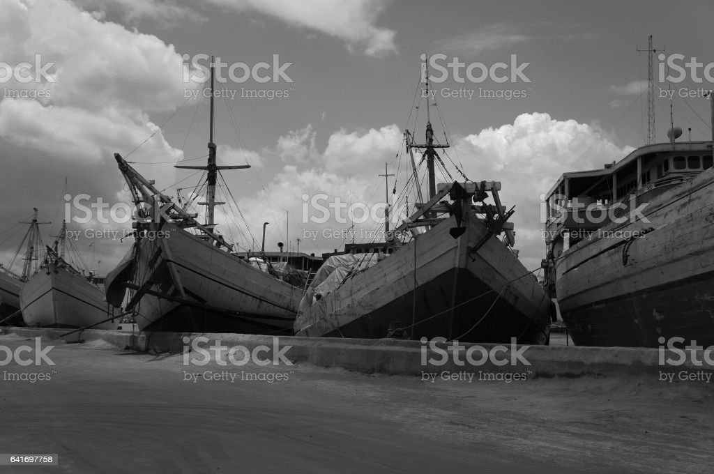 Old boats on Indonesian harbour stock photo