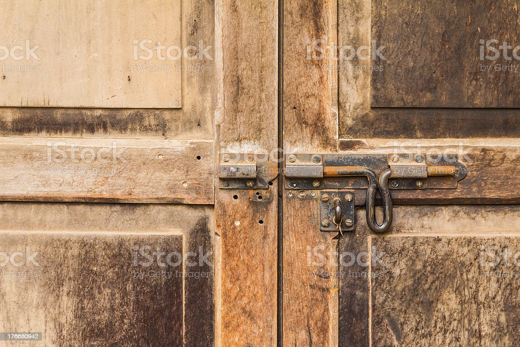 old bolt on a wooden door royalty-free stock photo