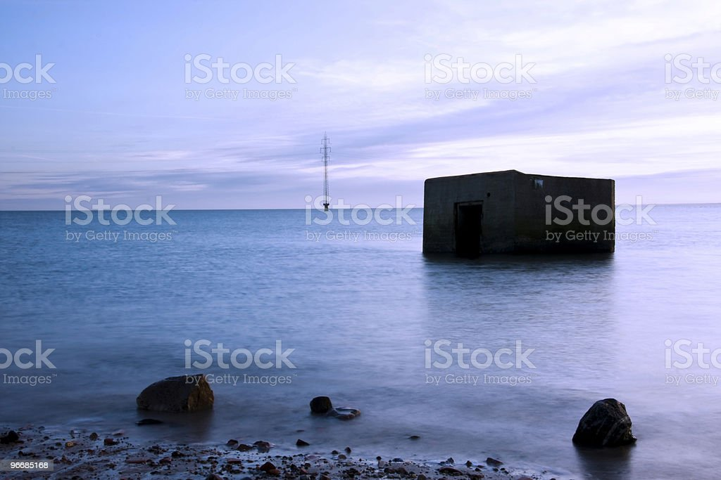 Old bomb shelter in water royalty-free stock photo