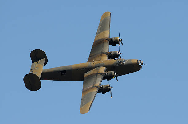 Old bomber in flight  bomber plane stock pictures, royalty-free photos & images