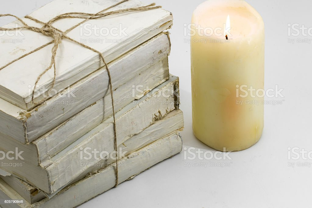 Old book and candle stock photo