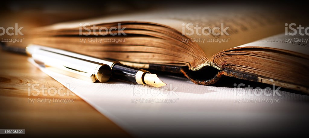 Old Book and Fountain Pen stock photo