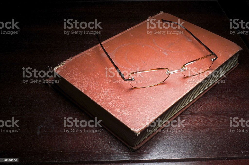 Old Book and Reading Glasses royalty-free stock photo