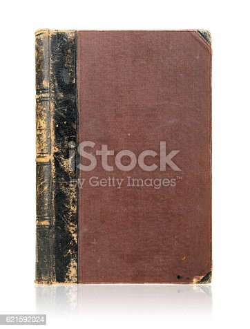istock Old book cover isolated on white 621592024