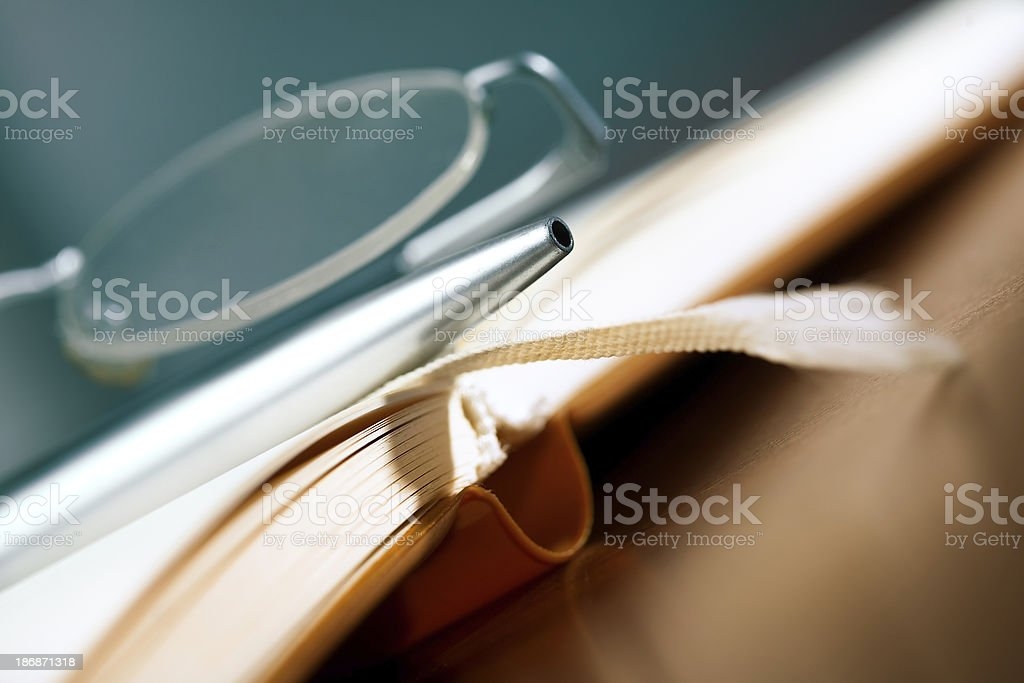 Old book, glasses and pen royalty-free stock photo