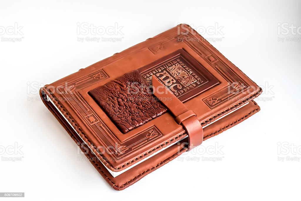 Old book in leather cover stock photo