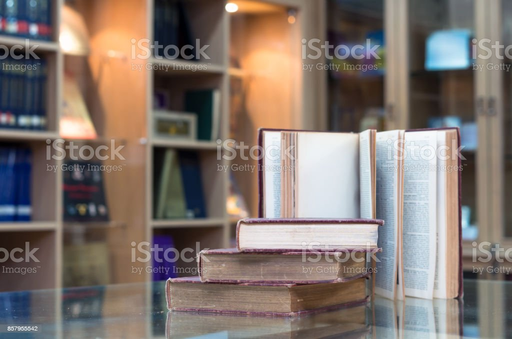 old book on the glass desk in library stock photo