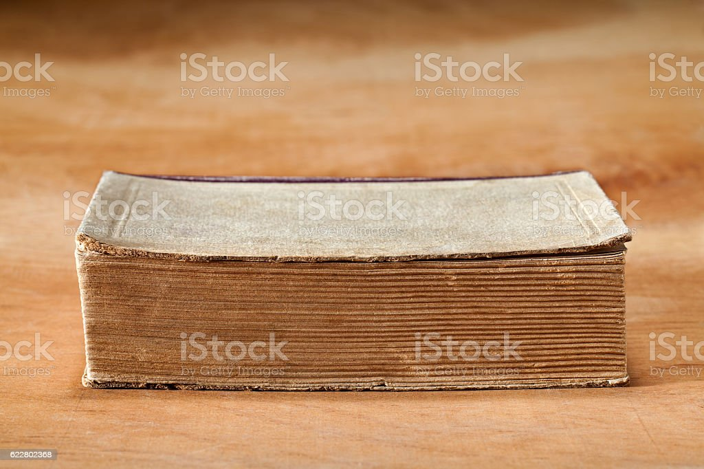 Old book on the table. stock photo