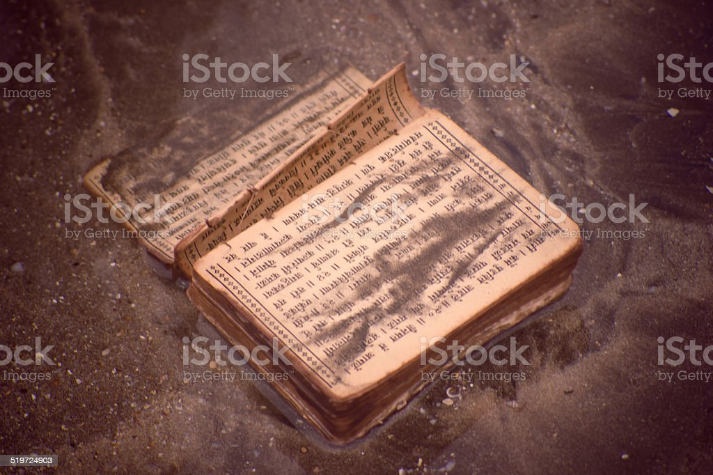 Old Book on water stock photo
