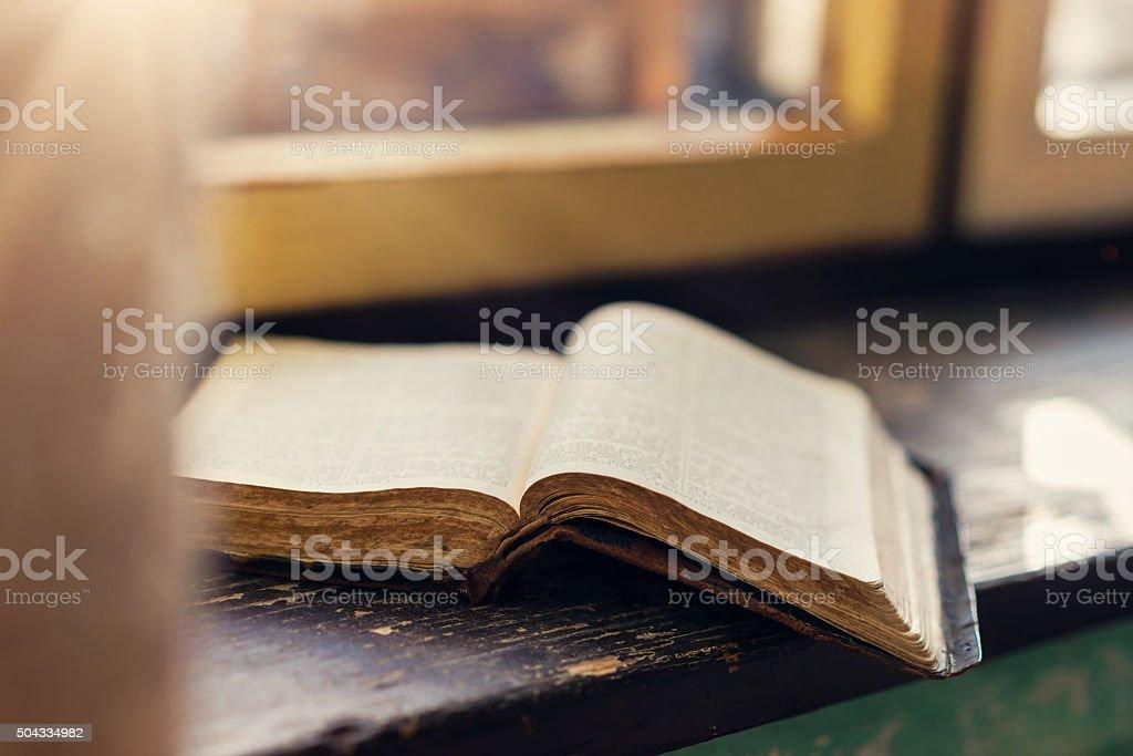 Old book on windowsill stock photo