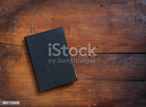 Old book on wooden background - copy space