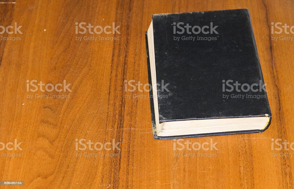 Old book on wooden table stock photo