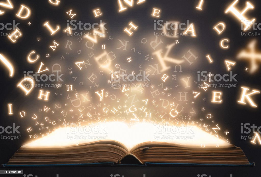 Old book open with flying magic letters Old book open with flying magic letters Art Stock Photo