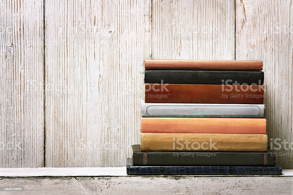 old book shelf blank spines cover, wood texture background, knowledge stock photo