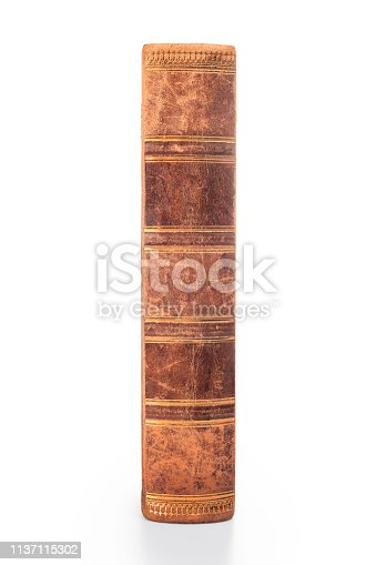 istock Old book spine isolated with clipping path 1137115302